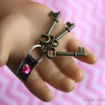 Scrapbook embellishment are perfect sized doll keys.  via Doll-It-Up.com - 4