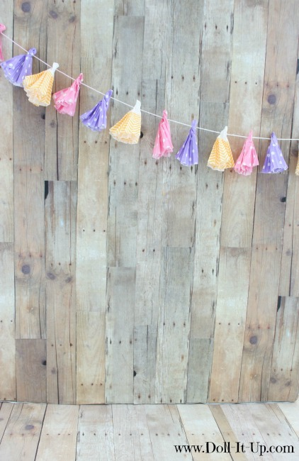 Doll size banner made with cupcake wrappers